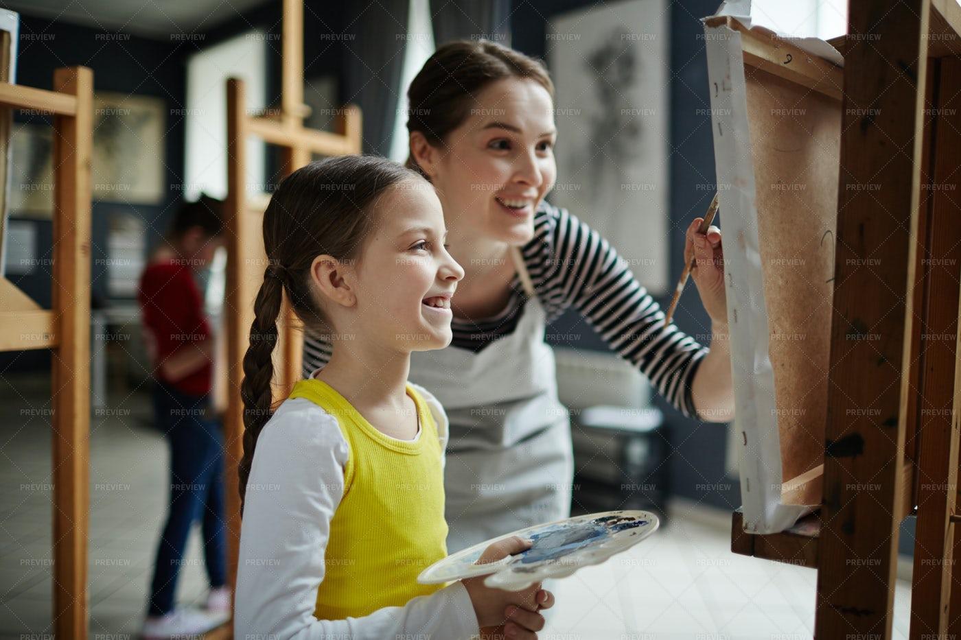 Girl Painting In Art Class: Stock Photos