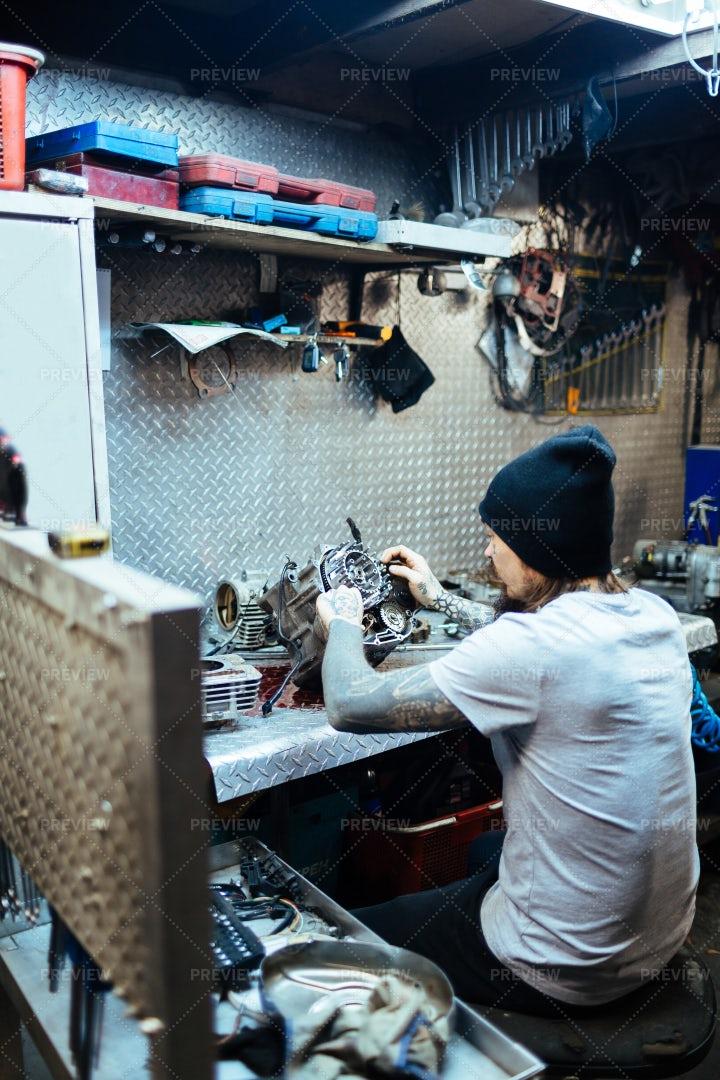 Auto Mechanic Repairing Parts In Garage: Stock Photos