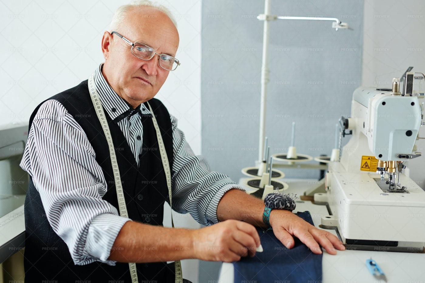 Experienced Tailor In His Atelier Studio: Stock Photos