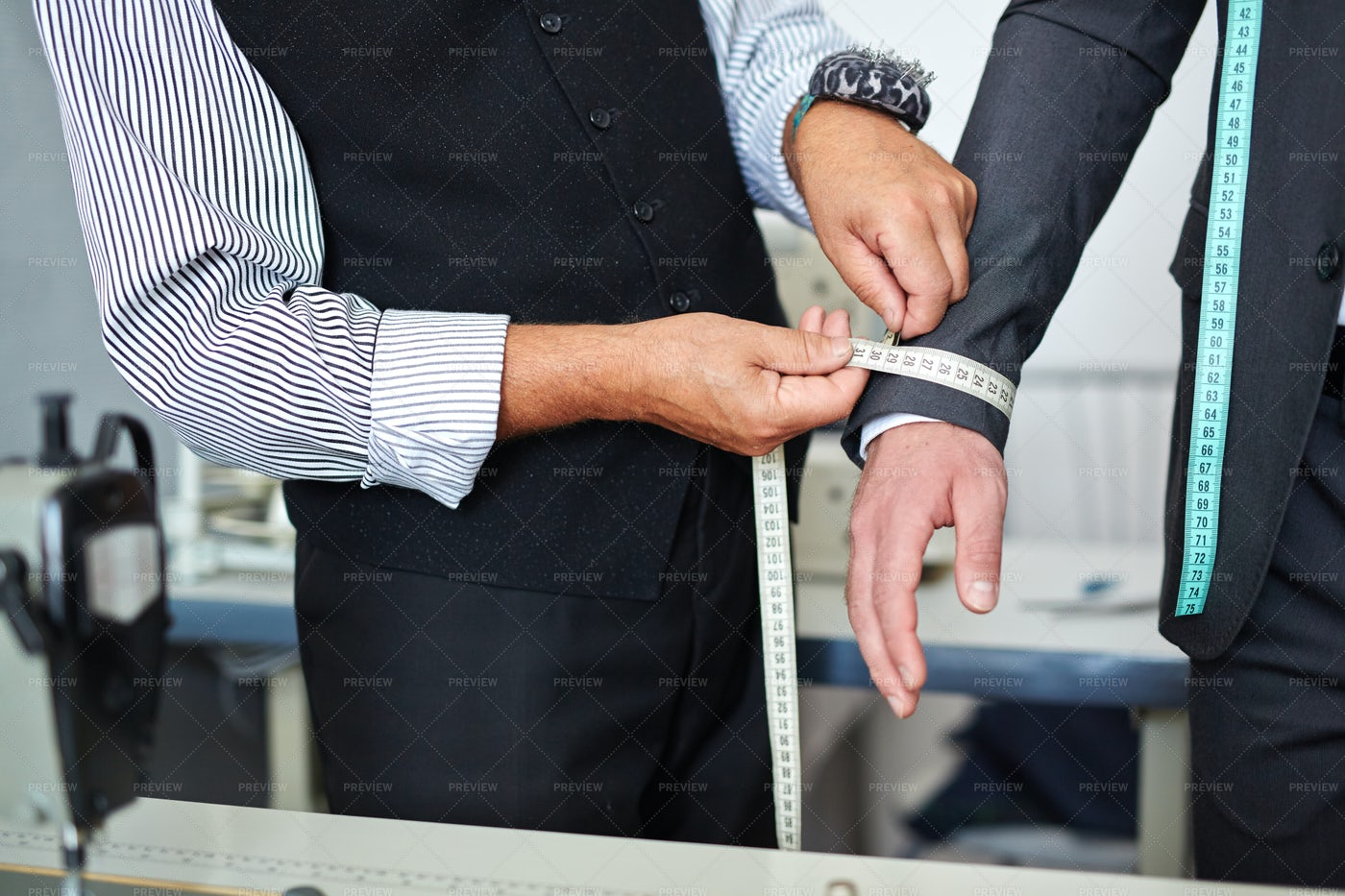 Tailor Taking Measurements In Atelier: Stock Photos
