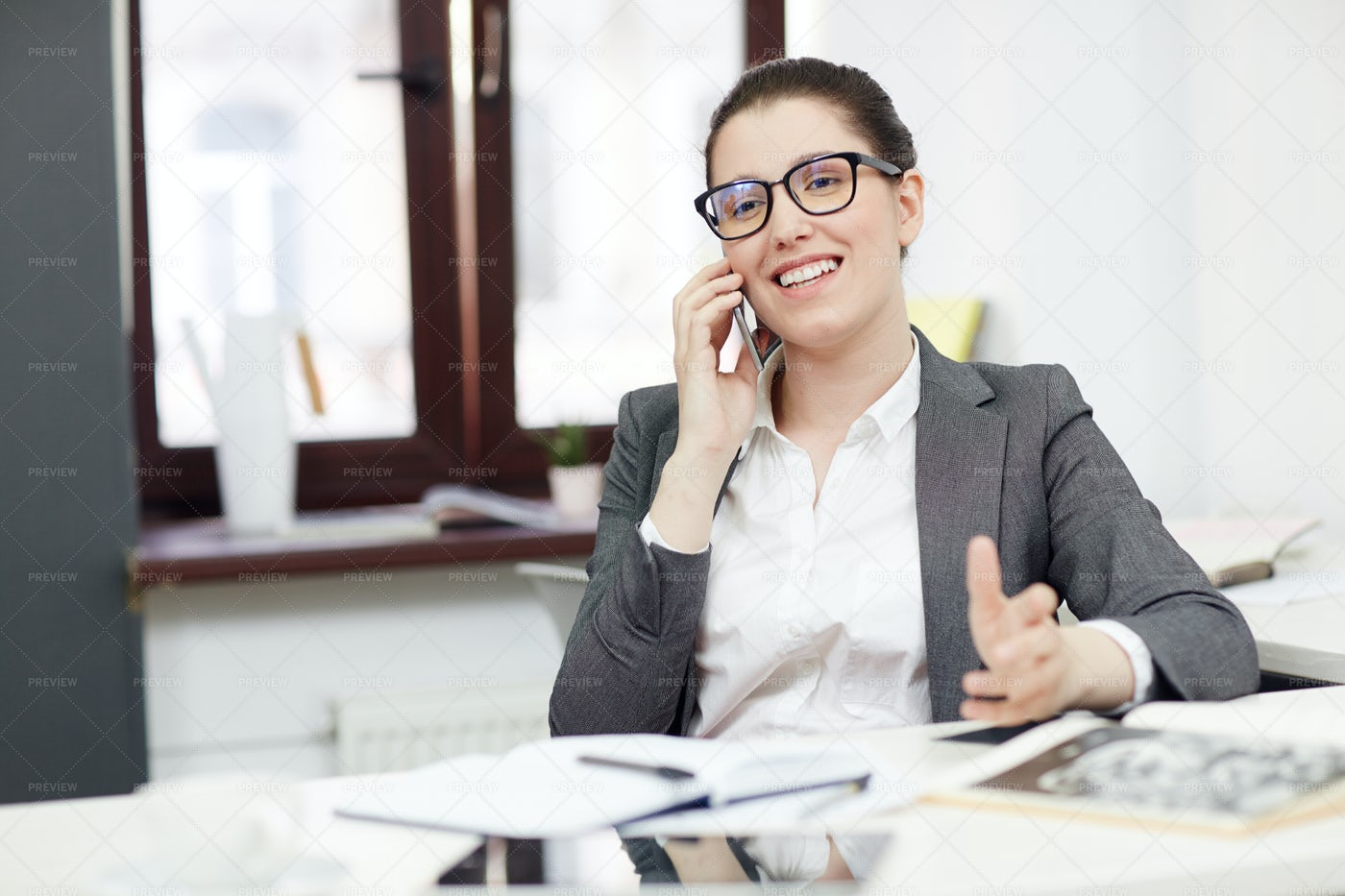 Smiling Businesswoman With Mobile Phone: Stock Photos