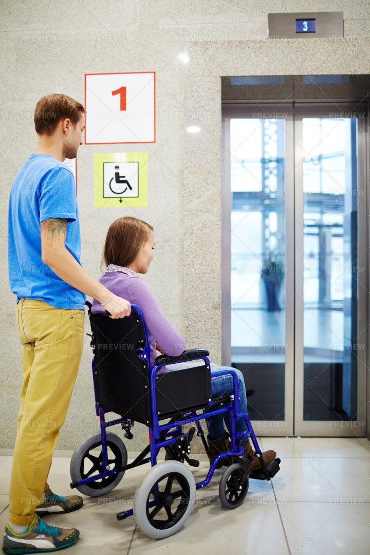 Handicapped Waiting For Elevator: Stock Photos