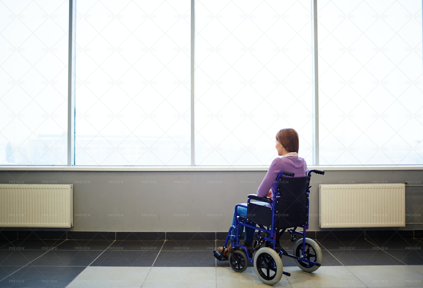 Thoughtful Woman In Wheelchair: Stock Photos