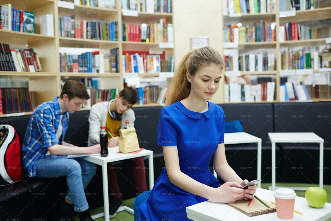 Students Working In Library Hall: Stock Photos
