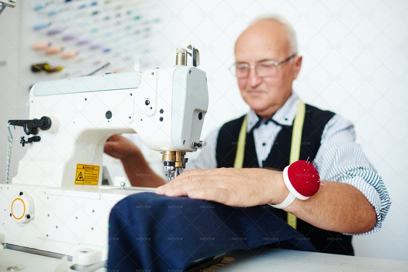Happy Old Tailor In Workshop: Stock Photos