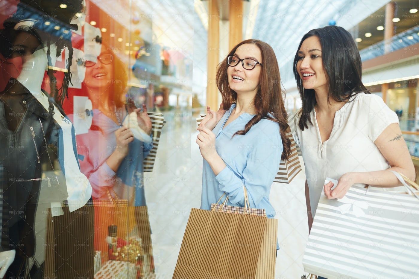 Girls By Shop-display: Stock Photos