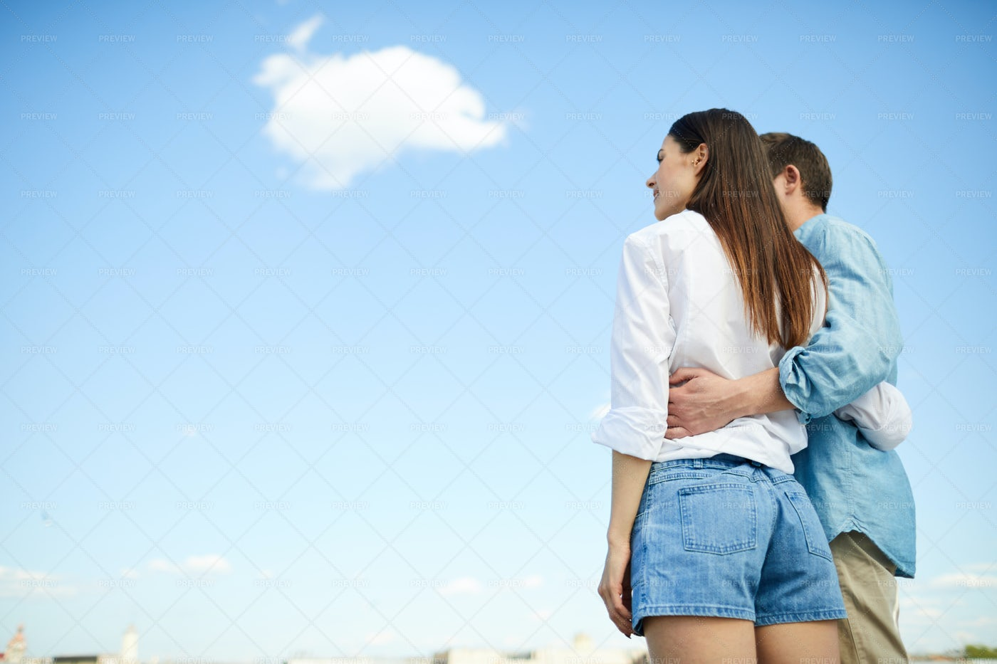 Dreamy Couple Looking At Sky: Stock Photos