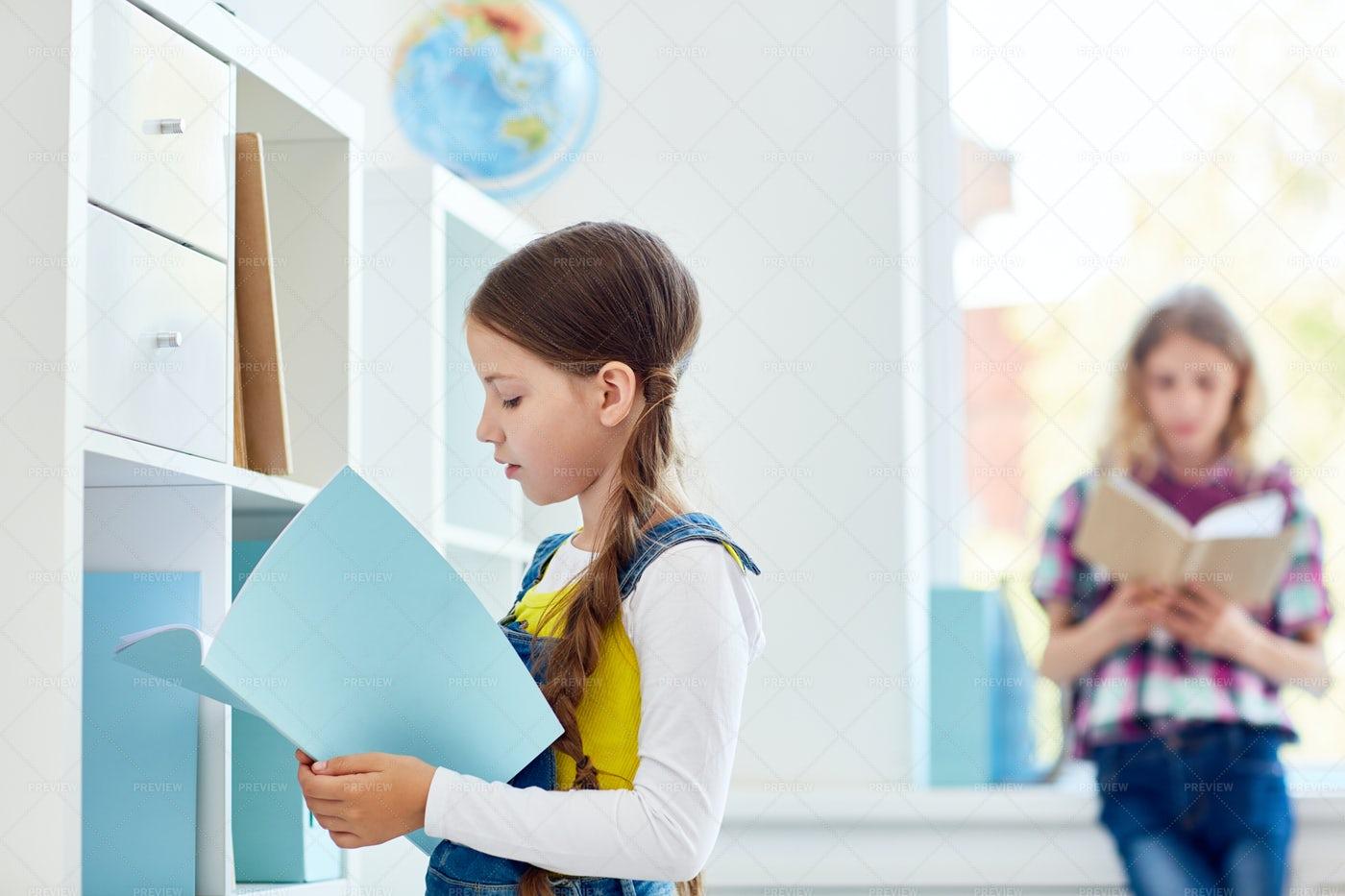 Schoolgirl In Library: Stock Photos