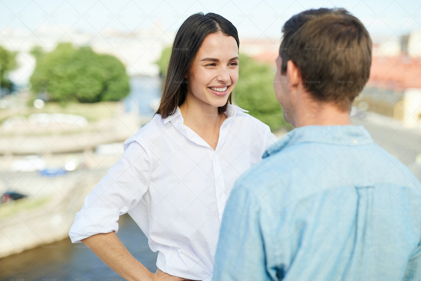 Positive Couple Chatting On Roof: Stock Photos