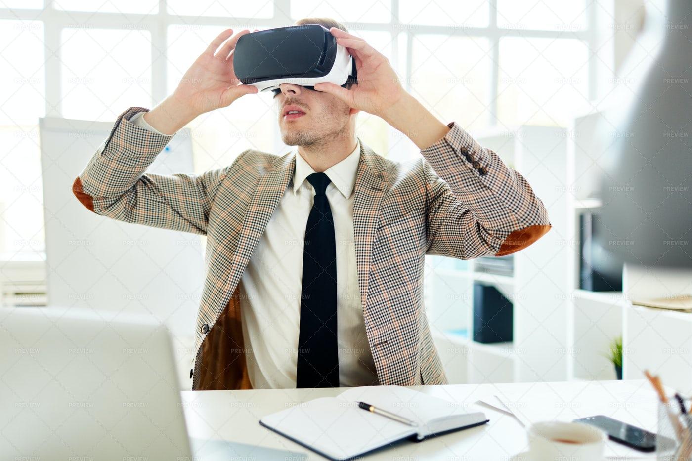 Interior Designer Using VR Headset: Stock Photos