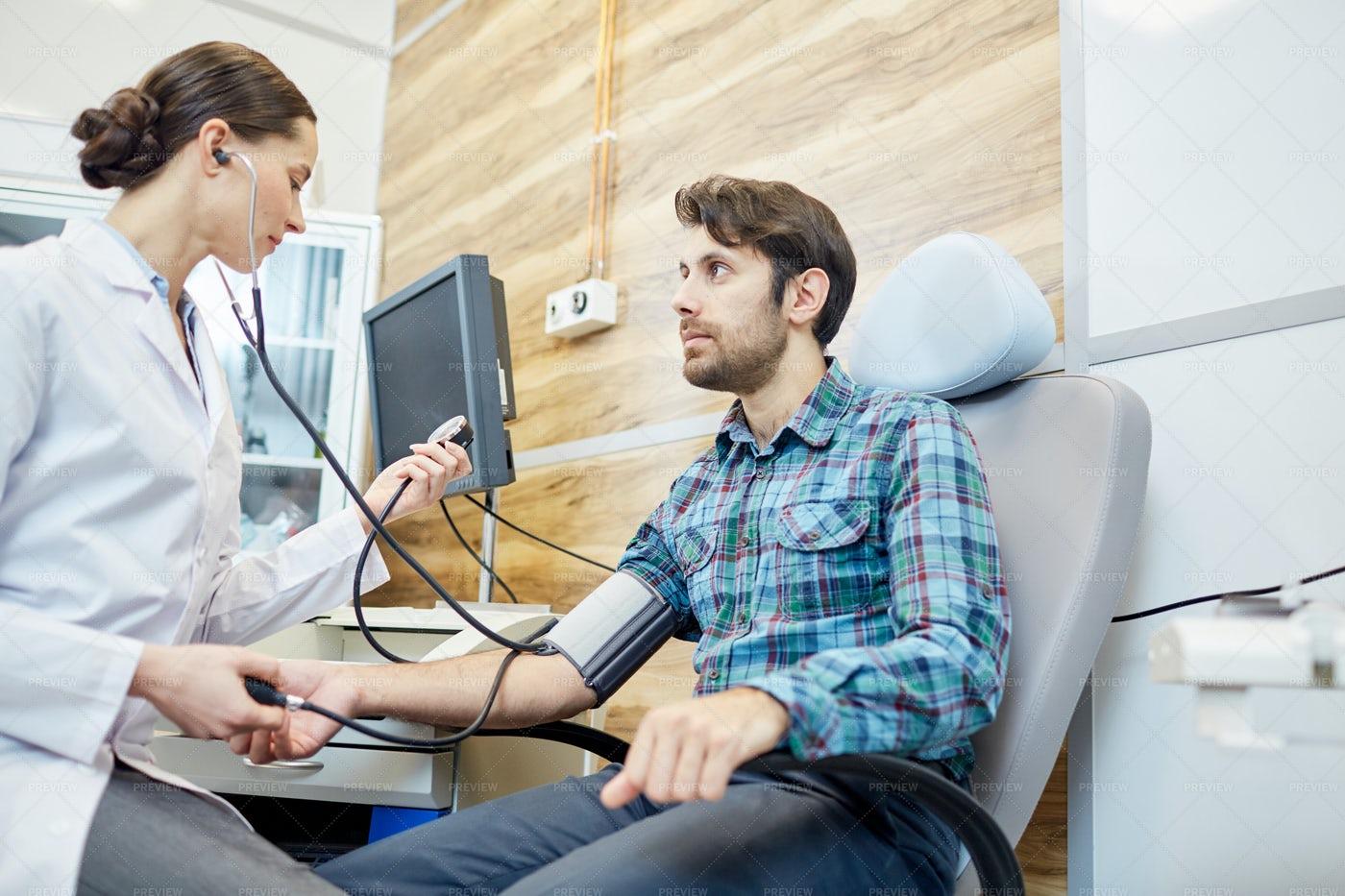 Doctor Examining Patient: Stock Photos