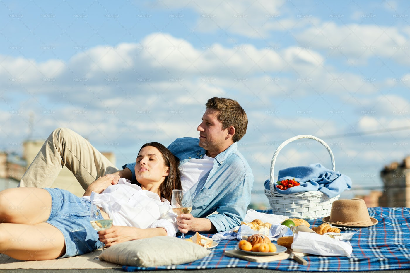 Relaxed Couple At Roof Picnic: Stock Photos