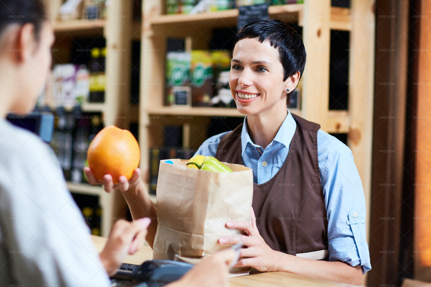 Attending To Customer In Grocery Store: Stock Photos