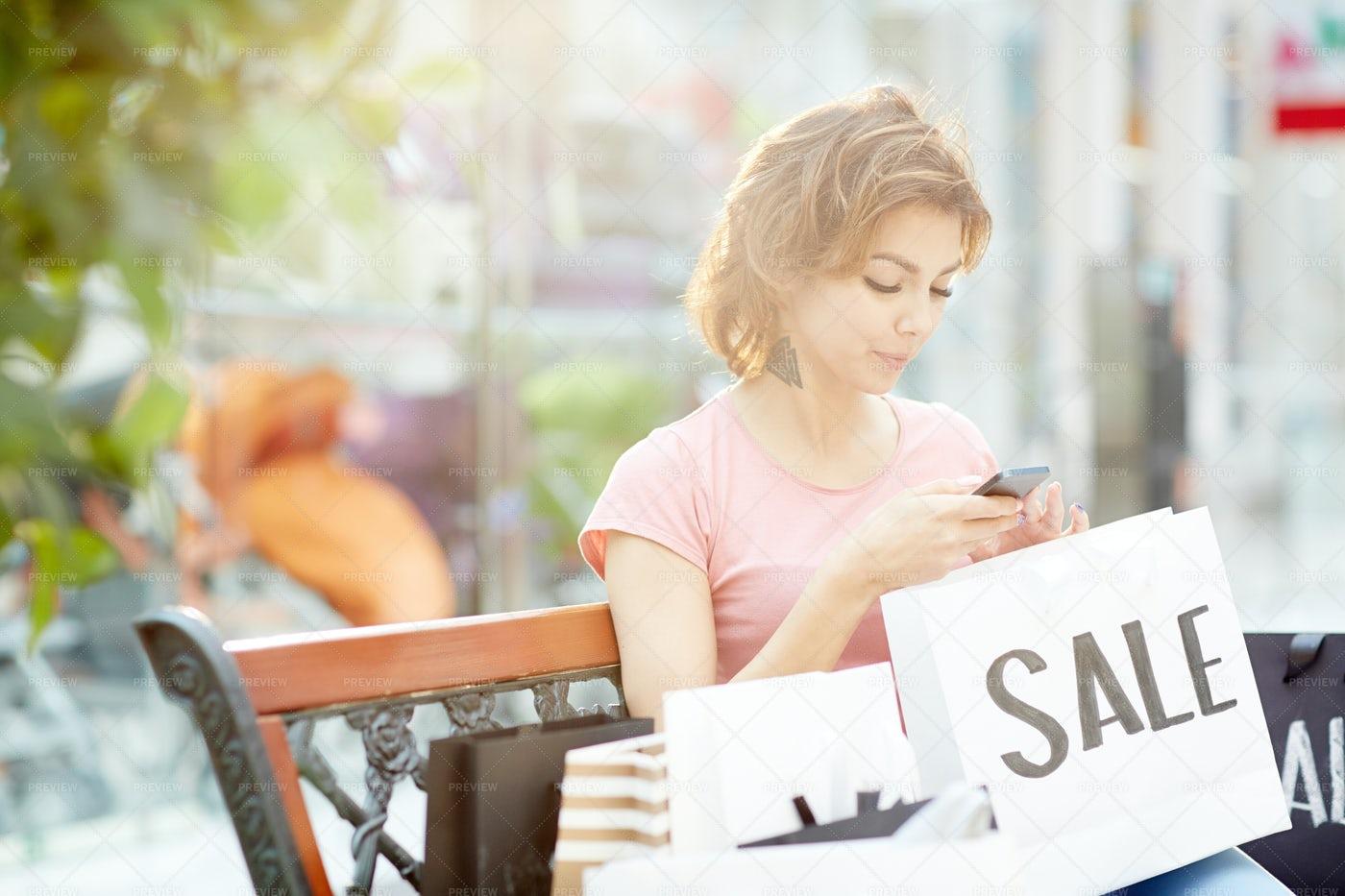 Shopper Texting: Stock Photos