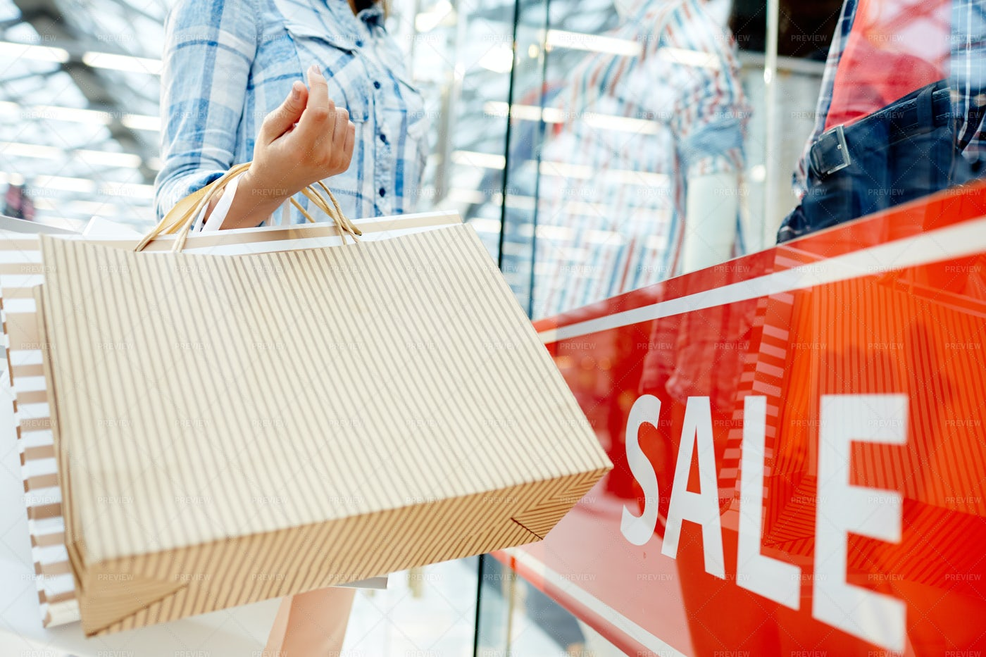 Shopper By Window Display: Stock Photos