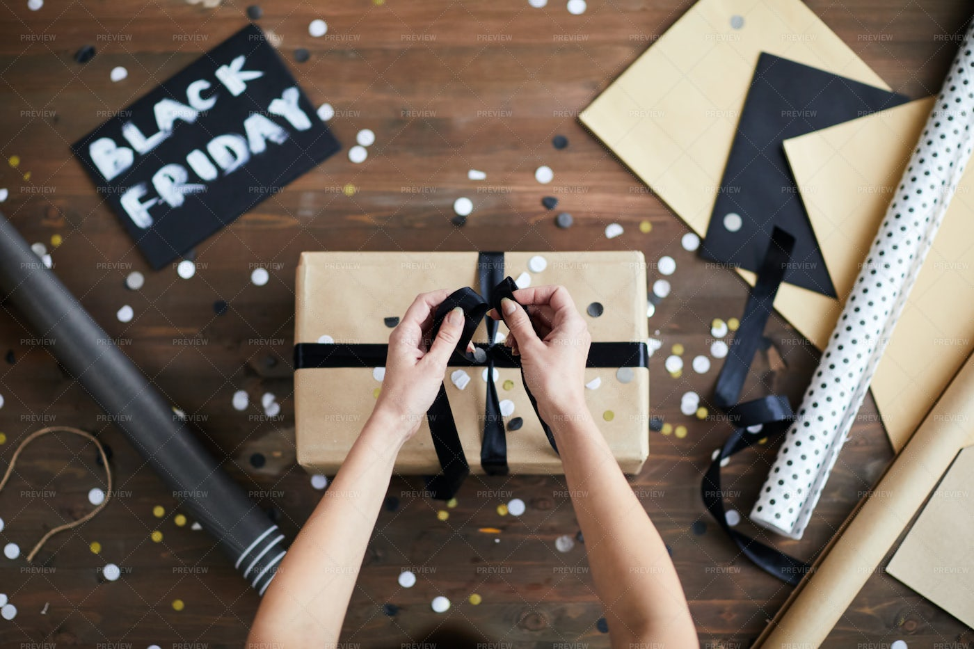 Woman Packaging Black Friday Gift: Stock Photos