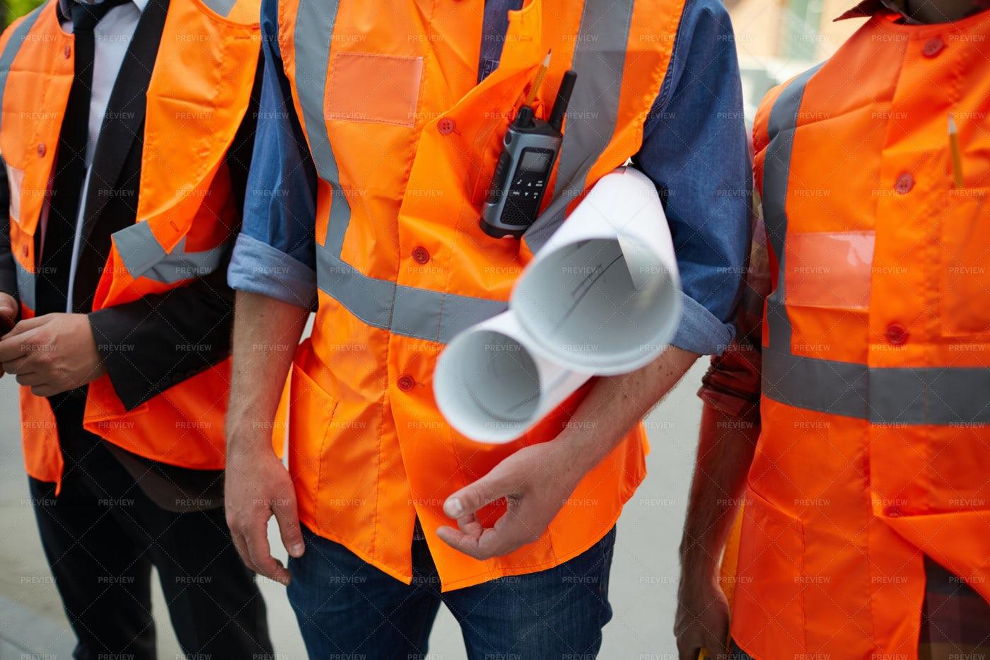 Closeup Of Workmen With Blueprints: Stock Photos
