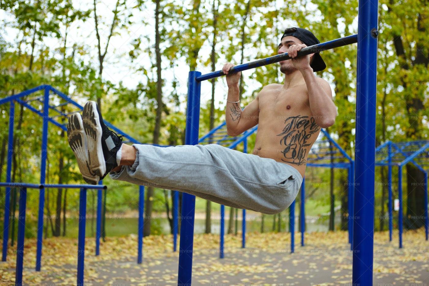 Exercising Abdominal Muscles On Bar: Stock Photos