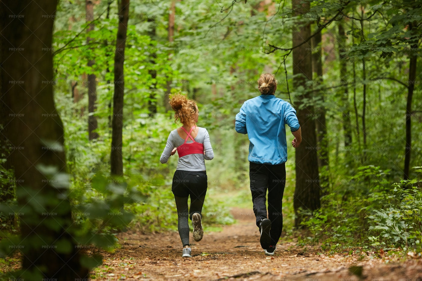 Jogging On Forest Path: Stock Photos