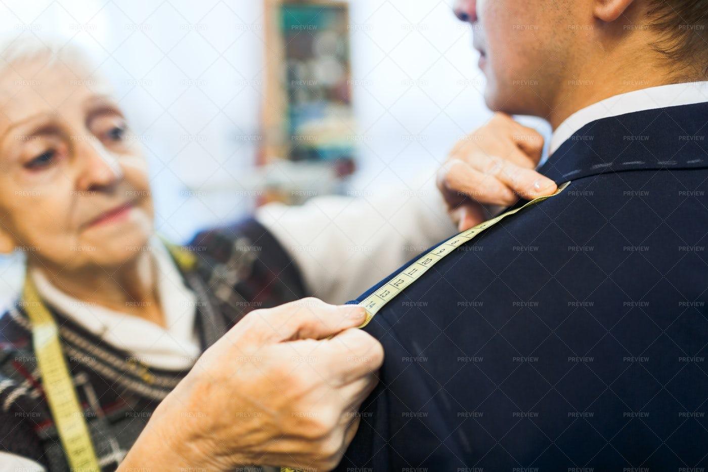 Measuring Length Of Jacket Shoulder: Stock Photos