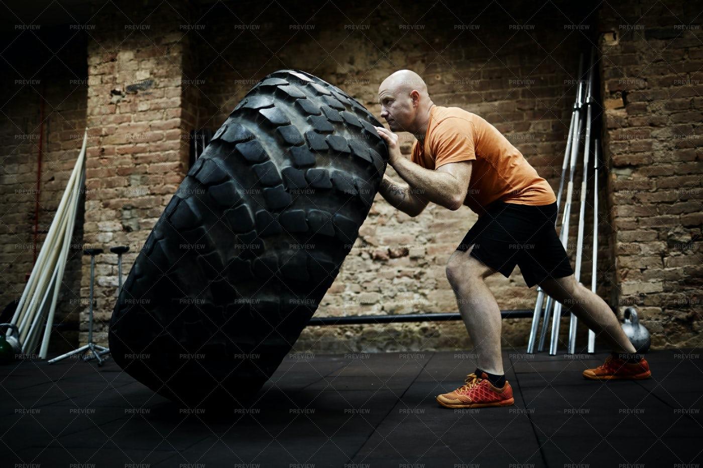 Athlete Focused On Tire Flipping: Stock Photos