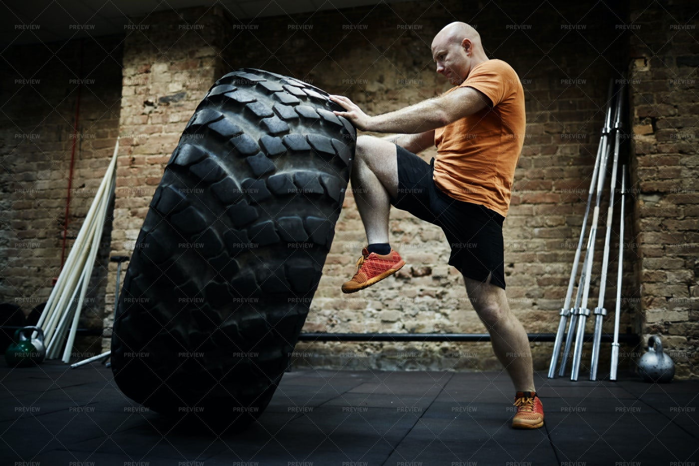 Exercising With Huge Tire: Stock Photos