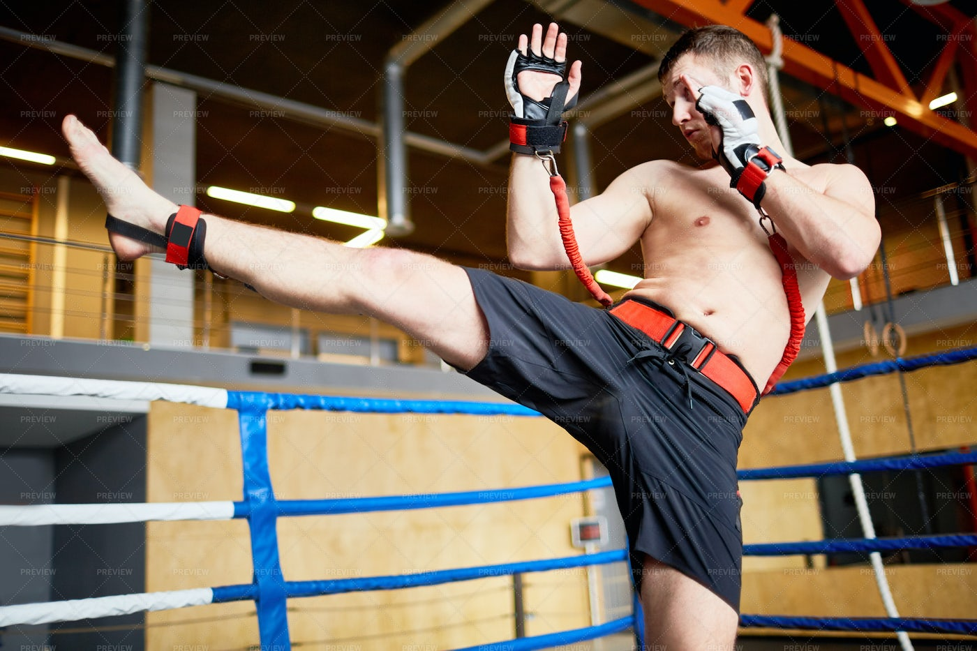 Kickboxer Training With Resistance Belts: Stock Photos