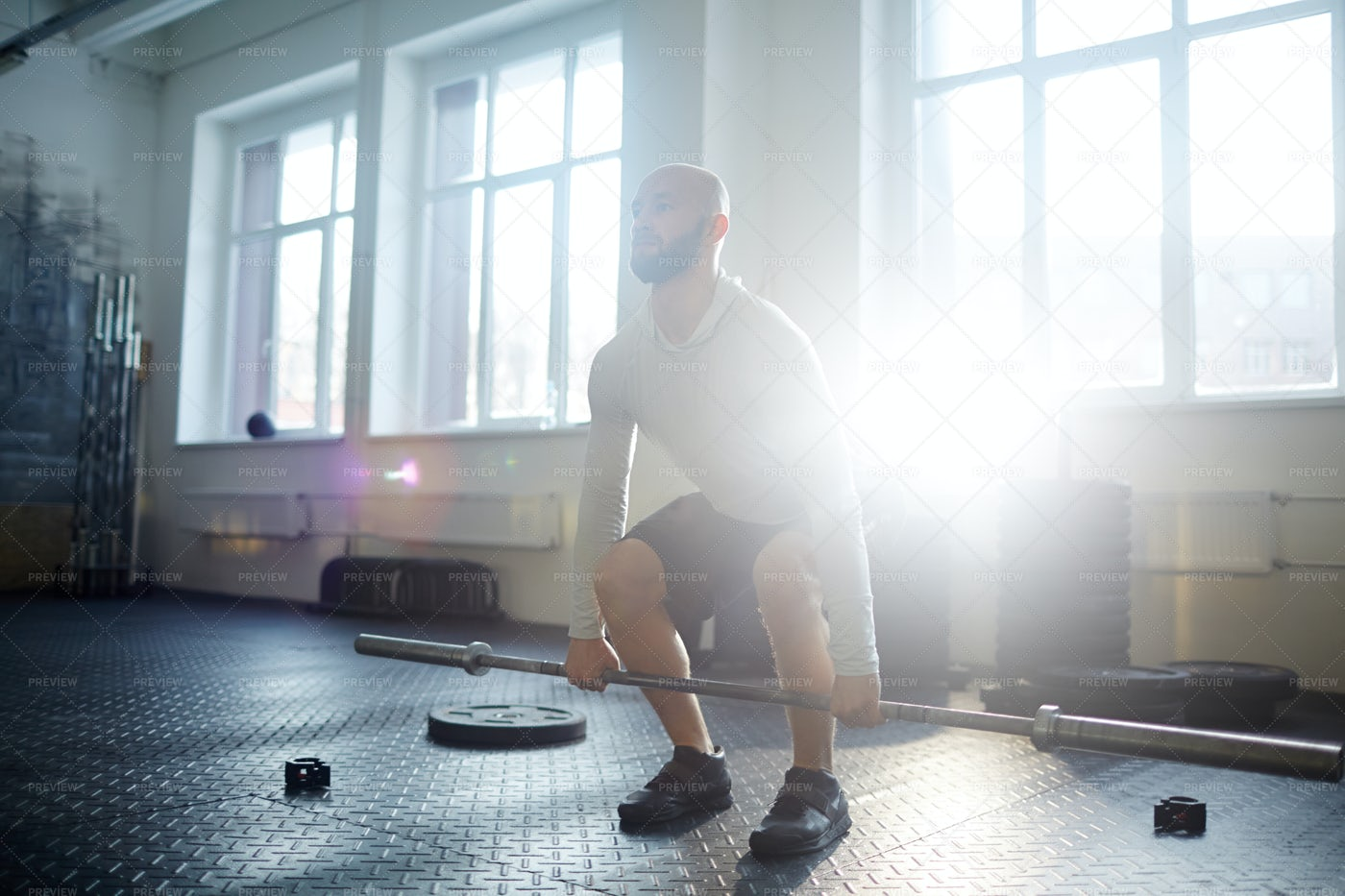 Weightlifting In Sunlit Gym: Stock Photos
