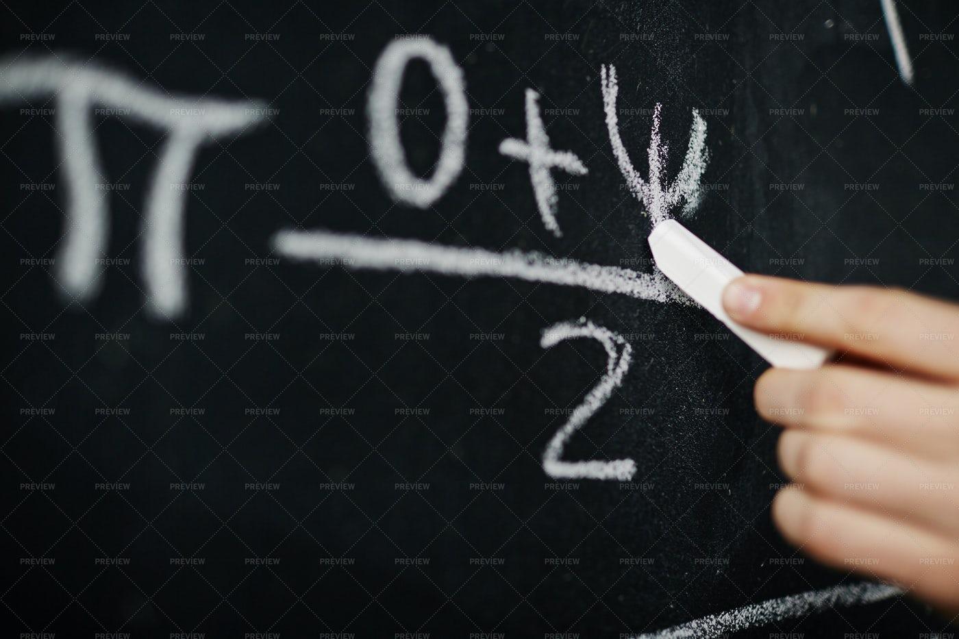 Hand Writing Math Formula On Blackboard: Stock Photos