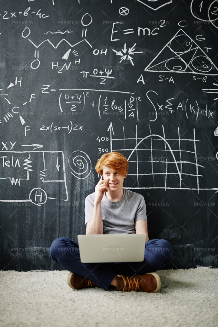 Smart Student Using Laptop And Phone: Stock Photos