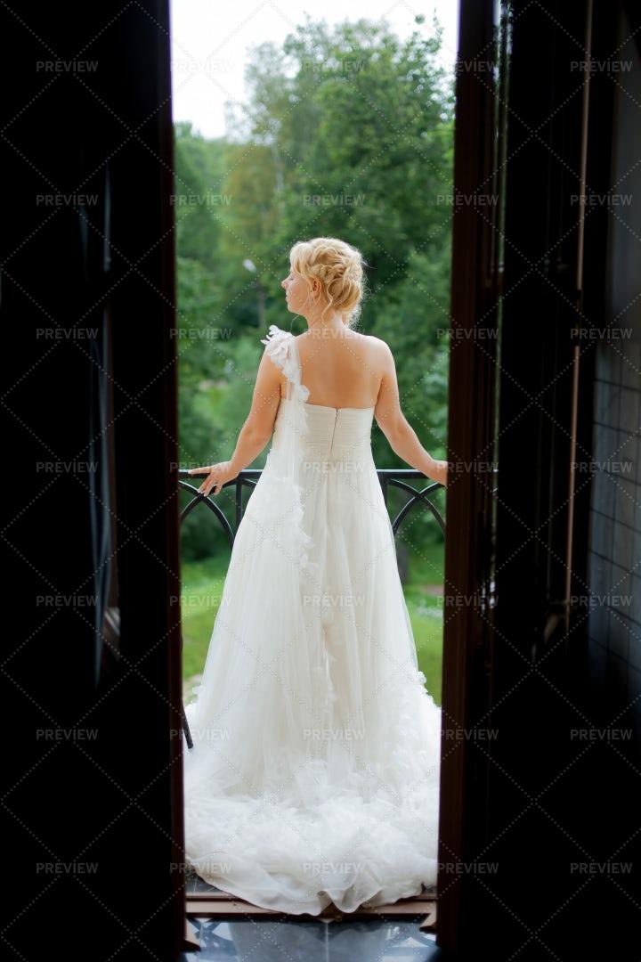 Bride At The Balcony: Stock Photos