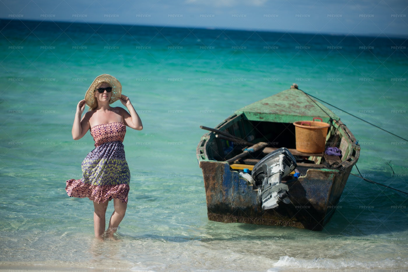 Woman Beside Motor Boat: Stock Photos