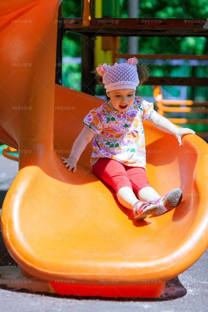 Child On A Playground Slide: Stock Photos