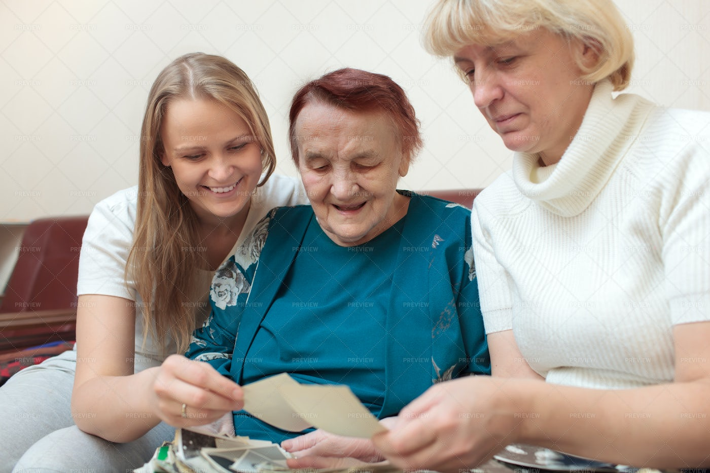 Three Generations Looking At Pictures: Stock Photos