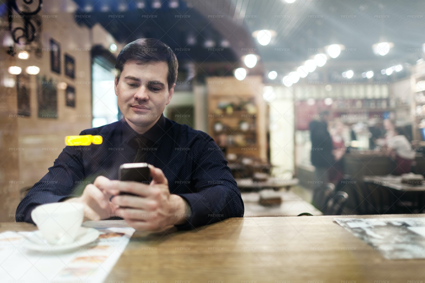 Messaging In A Cafe: Stock Photos