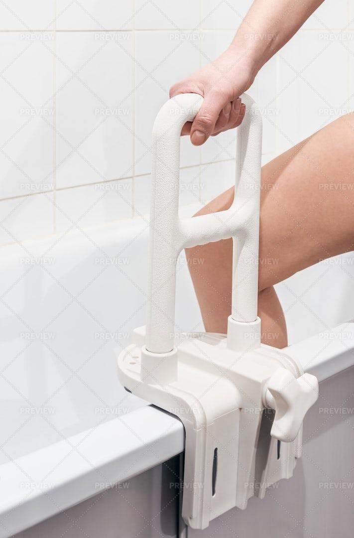 Holding Bathtub Handrail: Stock Photos