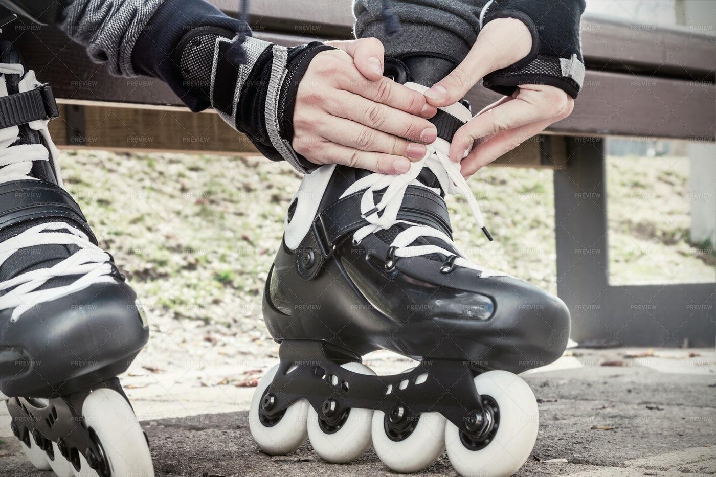 Fastening Rollerskates: Stock Photos