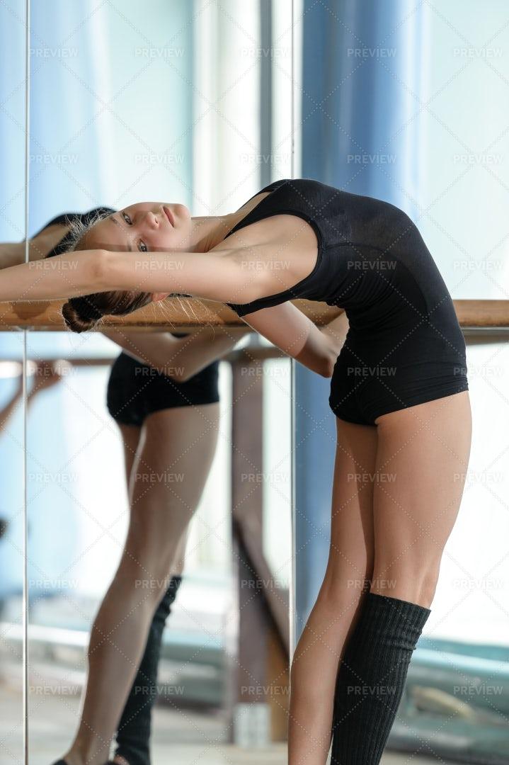 Ballet Dancer Stretches Backwards: Stock Photos