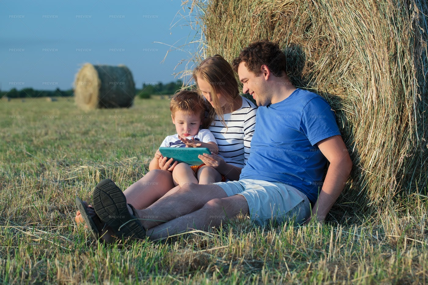 Family On Field With Ipad: Stock Photos