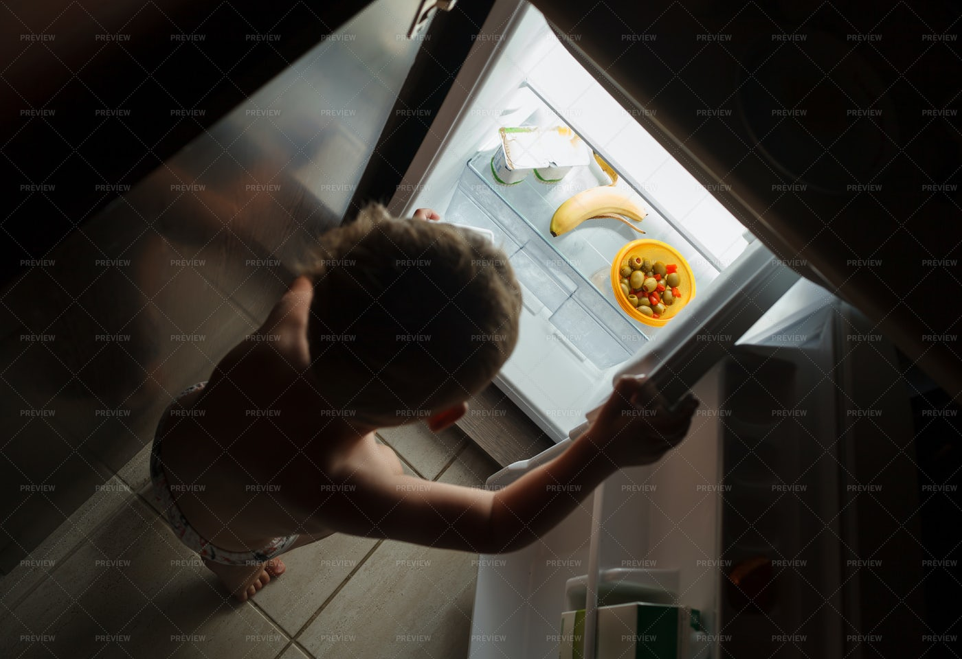 Little Hungry Boy At Night: Stock Photos