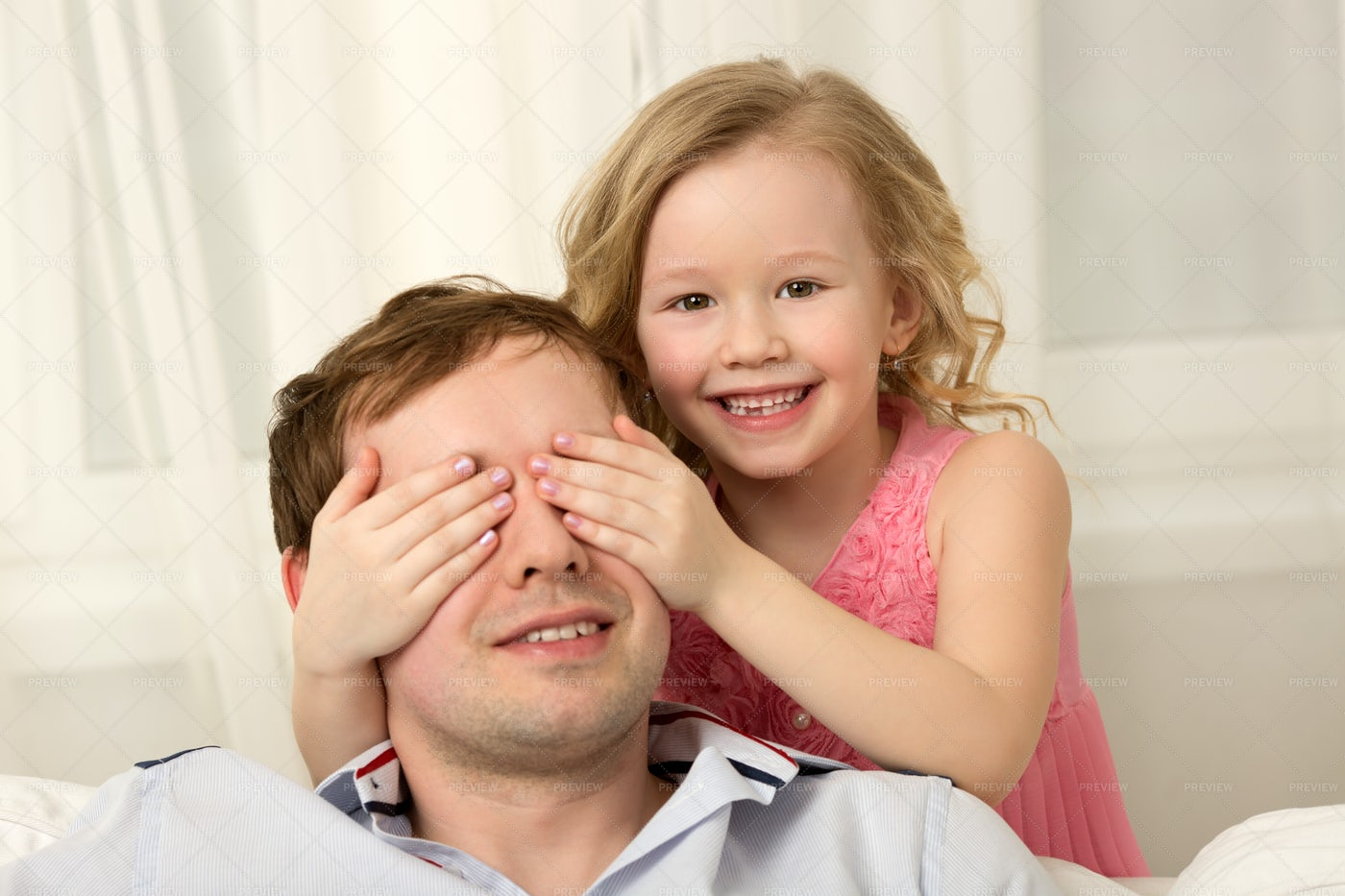 Playing Hide And Seek With Daddy: Stock Photos
