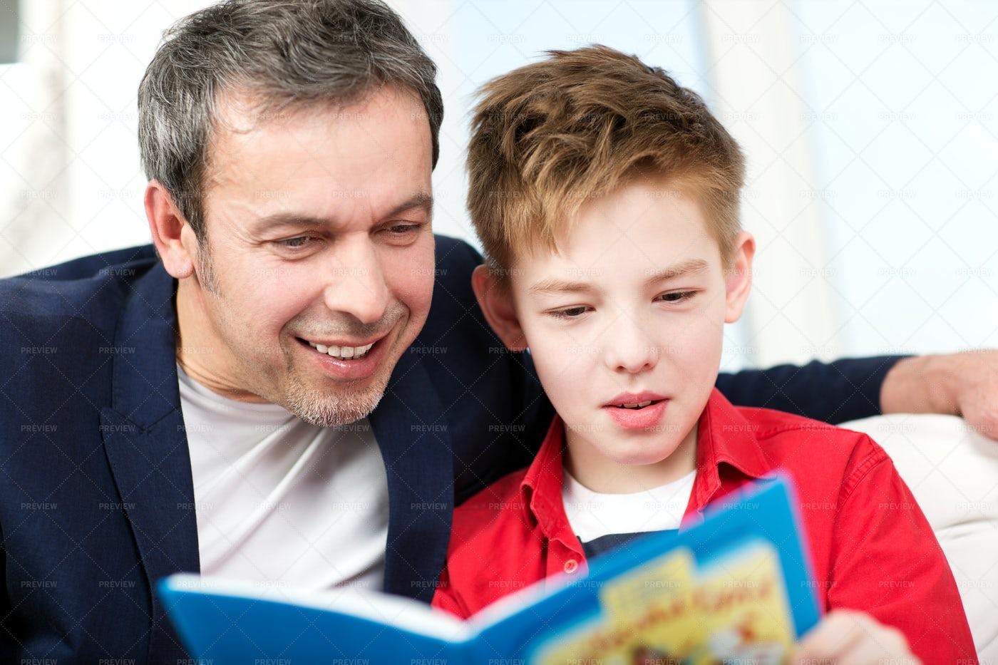 Father And Son Reading Book: Stock Photos