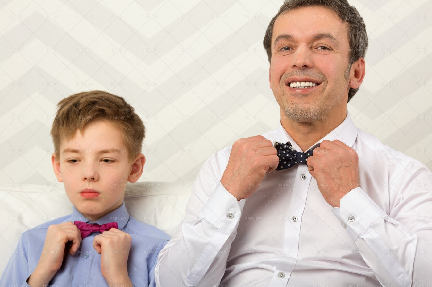 Father And Son Adjust Bowties: Stock Photos