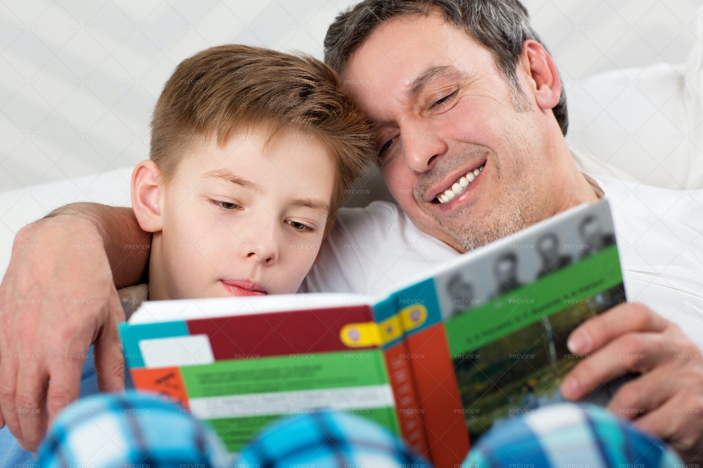 Reading A Book Together: Stock Photos