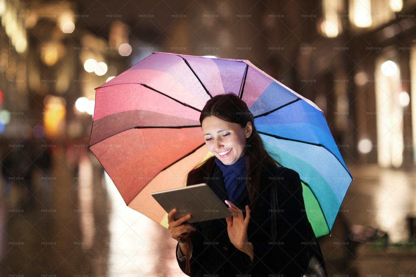 Using Ipad And Umbrella: Stock Photos