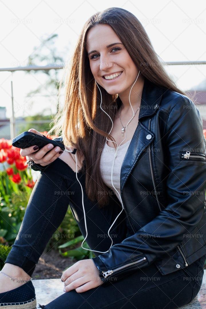 Woman In Headphones With Smartphone: Stock Photos