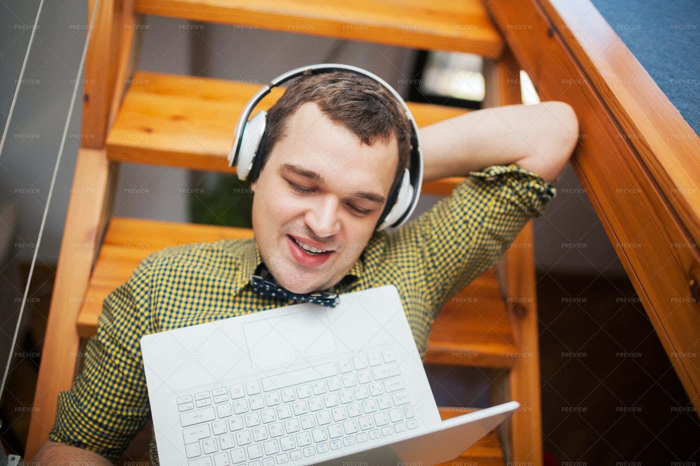 Listening To Music On Stairs: Stock Photos