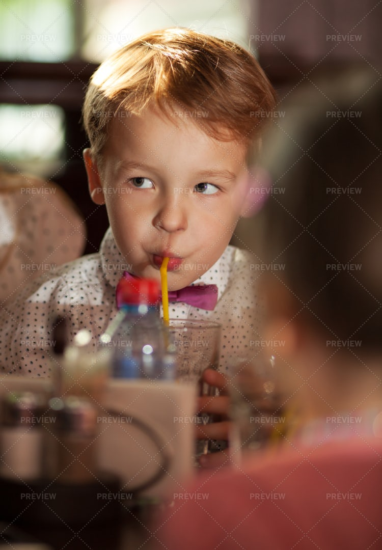 Boy Drinking Juice: Stock Photos
