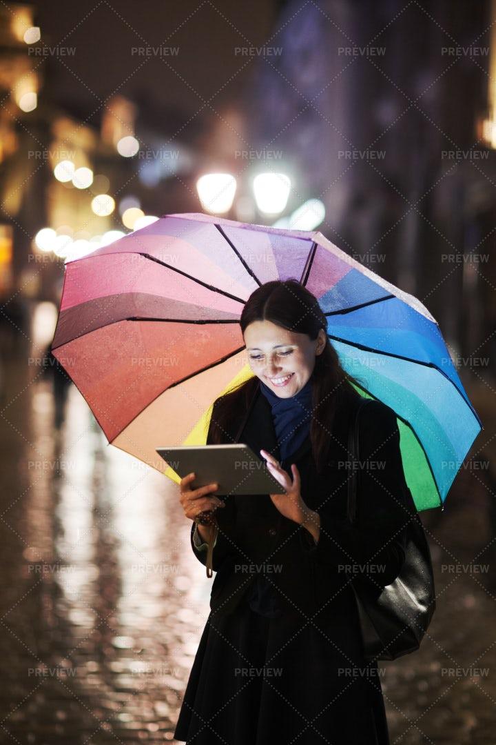 Using Tablet Under The Rain: Stock Photos