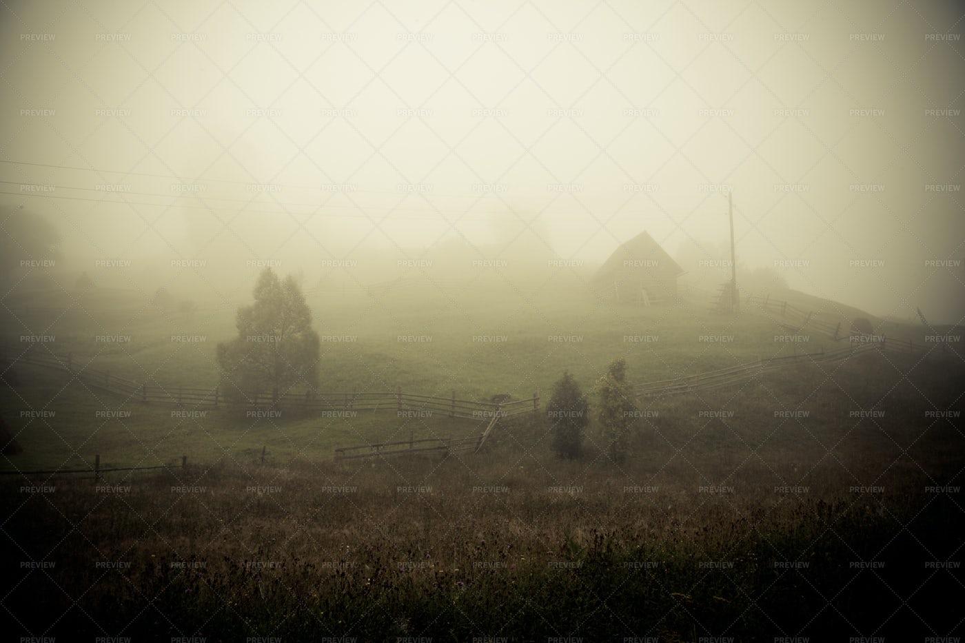 Hazy Fog Over Carpathian Village: Stock Photos